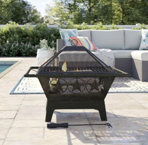 Outdoor wood burning firepit cooking Steel Grill Texas Star
